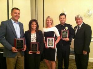 (From Left to Right) Tim Holder  - Vice President of Sales and Economic Development for EnergyUnited, Sally Ashworth – Executive Director of Visit Lake Norman, Tricia Sisson – Co-owner of The Range at Lake Norman and Huntersville Deputy Police Chief Michael Kee received the first Leadership Lake Norman L.A.K.E. Award from Chamber President & CEO Bill Russell